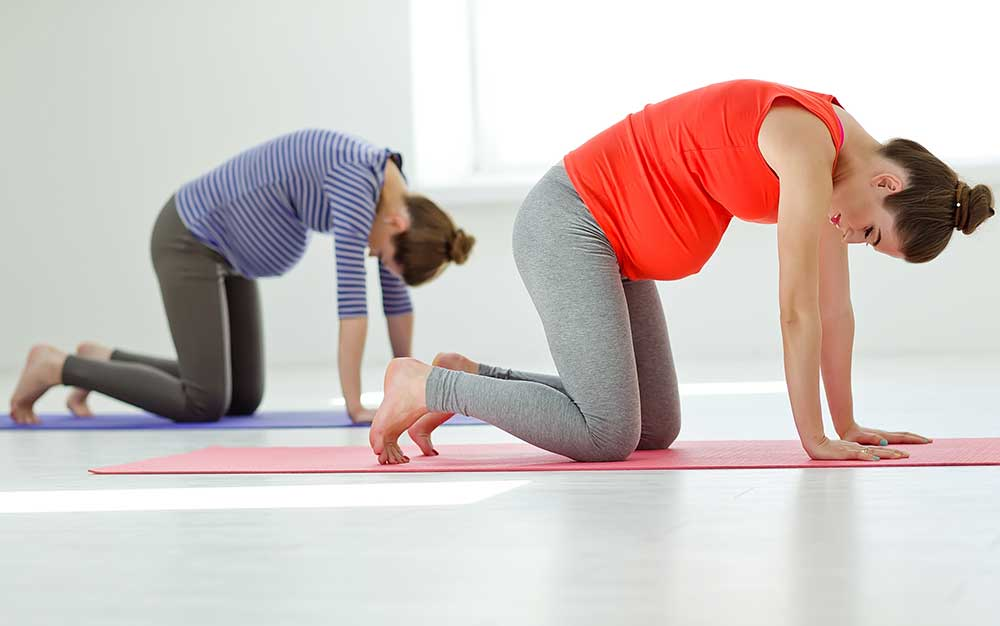 Pregnancy Pilates session in action image of